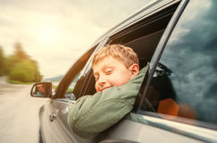 Boy look out from the car window Stock Image