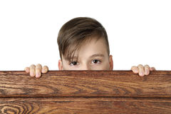 Boy look over fence Stock Photography