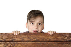 Boy look over fence Royalty Free Stock Photos