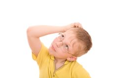Boy Look Up And Scratches His Head Stock Photography