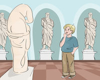 Boy looking at antique statue at museum Royalty Free Stock Image