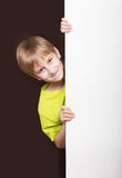 Boy looking around the corner Royalty Free Stock Photography