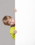 Boy looking around the corner Royalty Free Stock Photos