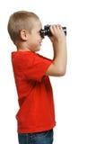 Boy looking away through the binoculars Royalty Free Stock Images