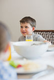Boy looking away at breakfast table. Cute boy looking away at breakfast table Stock Photos