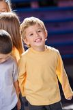 Boy Looking Away With Friends In Kindergarten. Happy little boy looking away with friends in kindergarten Stock Photography