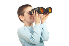 Boy looking through binocular. Isolated on white background Royalty Free Stock Images
