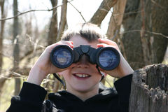 Boy Looking Through Binoculars Royalty Free Stock Photos