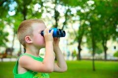 Boy looking through Binoculars Royalty Free Stock Images