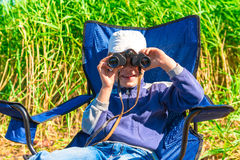 Boy looking through binoculars Royalty Free Stock Image