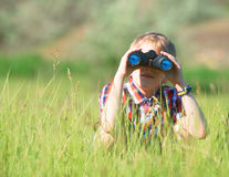 Boy looking through the binoculars Stock Photos