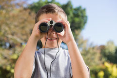 Boy looking through binoculars Stock Photos