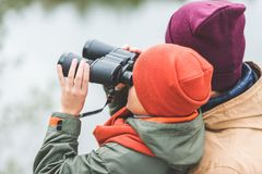 Boy looking through binoculars Royalty Free Stock Photos