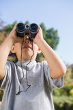 Boy looking through binoculars to the sky Stock Image