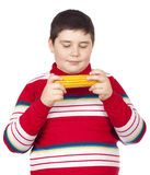 Boy looking at a boiled corn Royalty Free Stock Images
