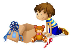 A boy looking at the box Stock Images
