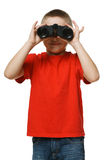 Boy looking at camera through the binoculars Royalty Free Stock Photography