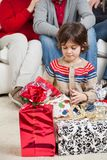 Boy Looking At Christmas Presents Stock Photography