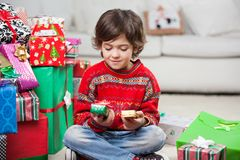 Boy Looking At Christmas Presents Royalty Free Stock Photography
