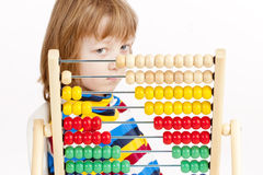 Boy Looking at Colorful Wooden Abacus Thinking Stock Photos