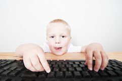 Boy looking at the computer screen Stock Images