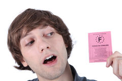 Boy looking at driving licence Stock Images
