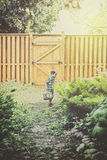 Boy Looking for Easter Eggs in a Garden - Retro Royalty Free Stock Photography