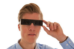 Boy looking through eclipse glasses. Boy with blue shirt looking through eclipse glasses Stock Photos