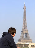 Boy looking at Eiffel Tower Stock Photography