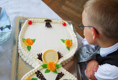 Boy looking at empty cake Stock Image