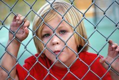 Boy, Looking, Fence, Chain Link Royalty Free Stock Photos