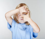 Boy looking through finger frame Stock Photography