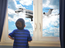 Boy Looking at Flying Airplane in Room royalty free stock photos