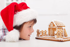 Boy looking at gingerbread house Stock Photo
