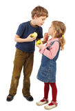 Boy looking on girl, children holding apples Royalty Free Stock Photos