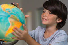 Boy looking globe of earth Royalty Free Stock Photo