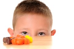 Boy Looking at Halloween Candy Royalty Free Stock Images