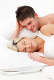Boy looking at her girlfriend sleeping Royalty Free Stock Photos
