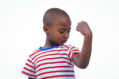 Boy looking his biceps. On white screen Royalty Free Stock Images