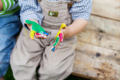 Boy looking on his colorful hands Royalty Free Stock Images