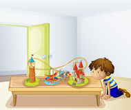 A boy looking at his toys stock illustration