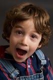Boy looking joyful. Six year old boy with a joyful exression Royalty Free Stock Photo