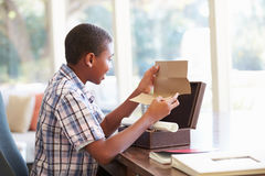 Boy Looking At Letter In Keepsake Box On Desk Royalty Free Stock Photography