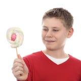 Boy looking at lollipop Stock Photos