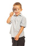 Boy looking through magnifier Stock Image