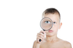 Boy looking through a magnifying Stock Photo