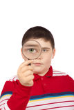 Boy looking through a magnifying Stock Photography