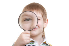 Boy looking through magnifying glass Royalty Free Stock Photo
