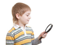 Boy looking with  magnifying glass Stock Photo