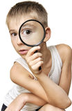 Boy looking through a magnifying glass Stock Photos